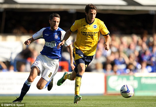 Battle: Ipswich Town's Cole Skuse (left) and Brighton & Hove Albion's Will Buckley compete for the ball