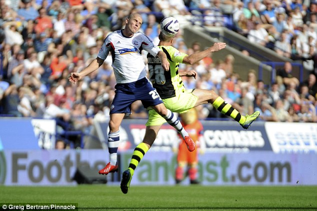 Aerial challenge: Marc Tierney (left) and Andy Williams go up for a header