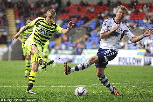 Strike a pose: Paddy Madden of Yeovil Town strikes at goal