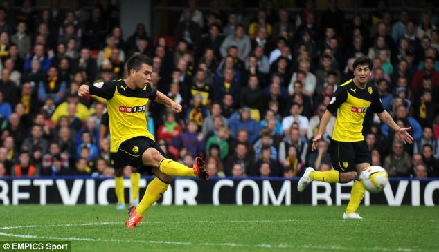 Finish: Watford's Cristian Battocchio sweeps home a late winner