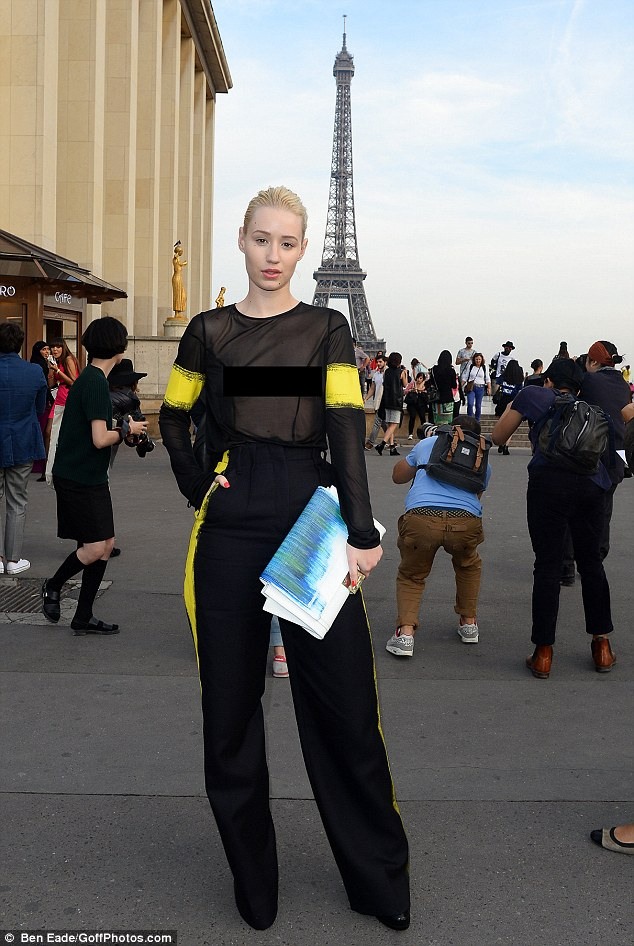 What a backdrop: Iggy posed up in  front of the Eiffel Tour as tourist continued taking pictures around her