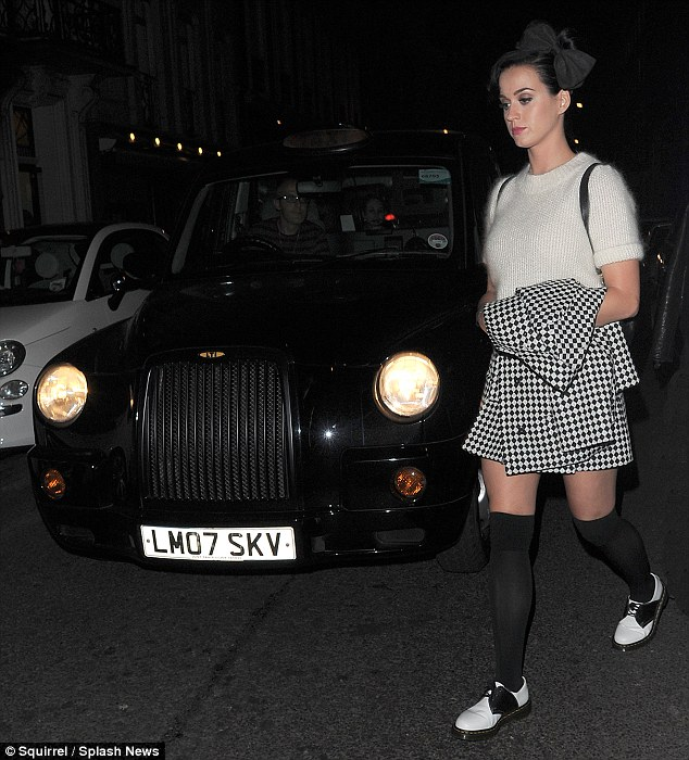 City style: The 28-year-old looked like she had walked off a stage in knee socks, a fluffy jumper and gingham coat