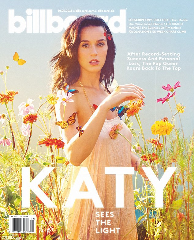 Butterfly queen: Katy surrounds herself with colourful creatures as she poses on the cover of Billboard magazine in which she gave the interview