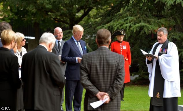 Interment: Reverend Richard Whittington (right) reads a short address during the interment of the ashes of Lady Thatcher