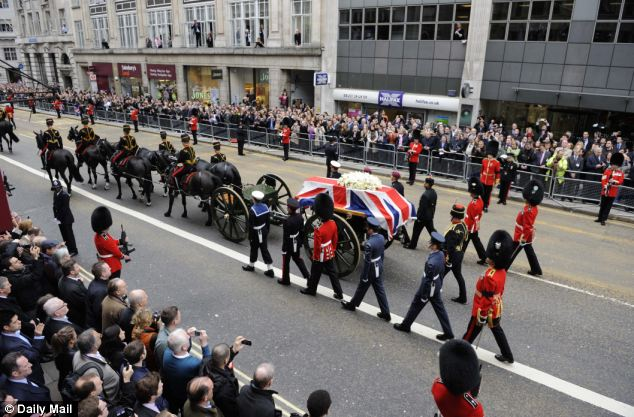 Cortage: Thousands also lined the streets of London to pay their respects as the coffin bearing her body was brought in procession to the cathedral on a gun carriage drawn by six black horses