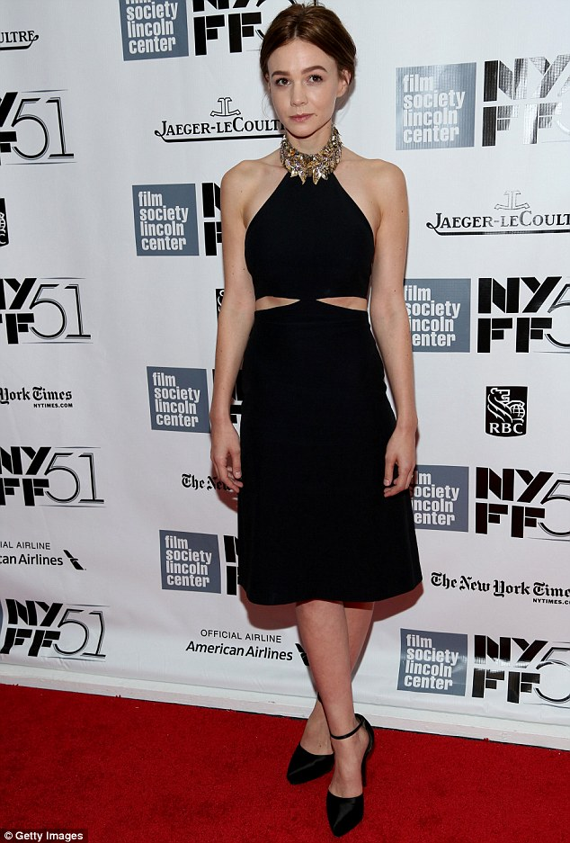 English rose: Carey Mulligan looks every inch the english rose as she attends the premiere of her latest film Inside Llewyn Davis in New York on Saturday