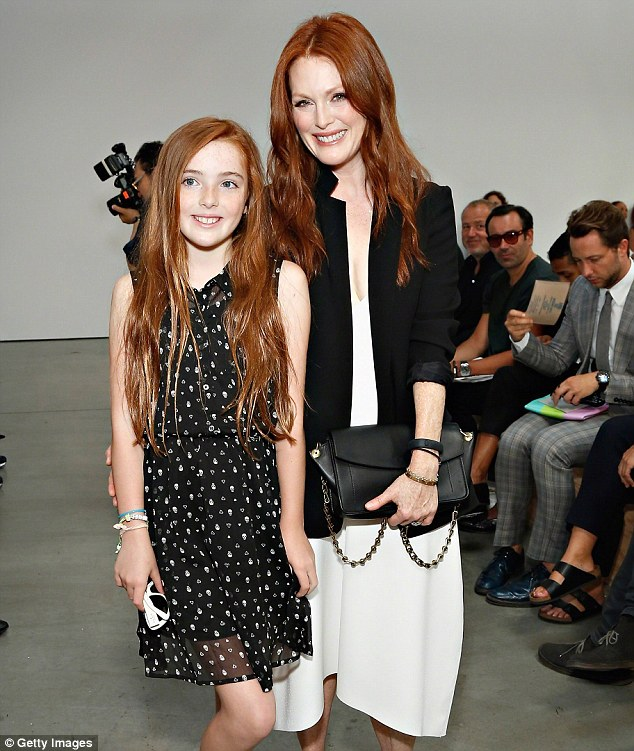 Proud mum: Julianne smiled as she posed with her mini-me during New York Fashion Week
