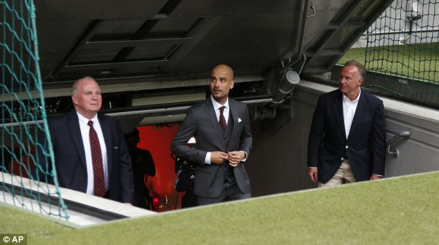 Rummenigge (right) shows Pep Guardiola (middle) around Bayern Munich's Allianz Arena with club president Uli Hoeness