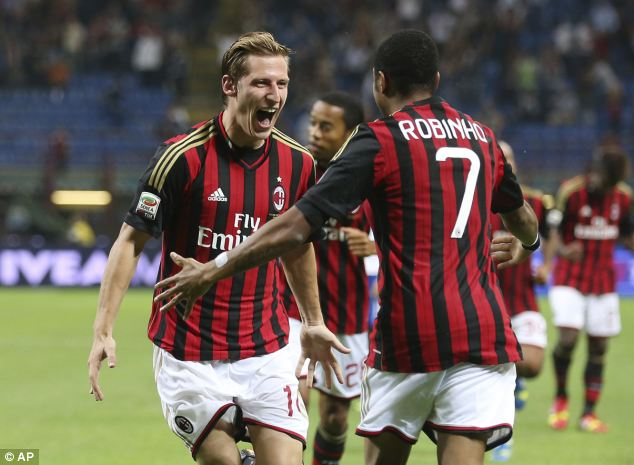 Relief: Valter Birsa celebrates his winning goal with Brazilian Robinho