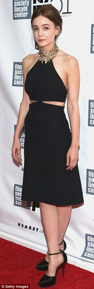 Svelte: The 28-year-old showed off her trim figure in a black dress with cut out detail