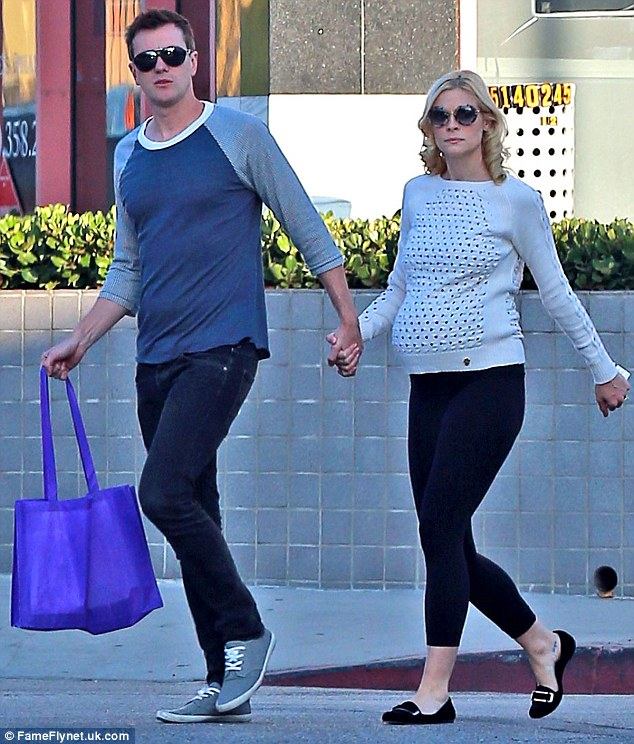 Maternity chic: Jaime, pictured here out with Kyle earlier in September, has made a statement with her pregnancy style since announcing that she was expecting her firstborn