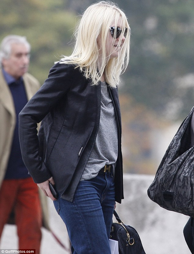 Off-duty fashionista? Dakota Fanning takes to the streets of Paris during Paris Fashion Week on Monday