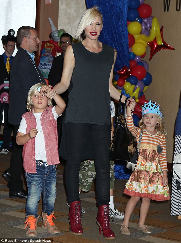 Bright star: Gwen Stefani flashes a bright smile as she takes her sons Kingston, seven and five-year-old Zuma and her niece Stella to the party
