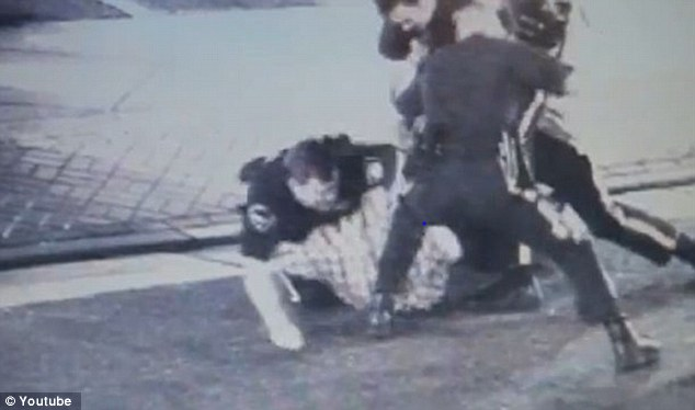 Violent: One police officer was filmed repeatedly striking Mr Castellani with a baton as his colleagues wrestle with him