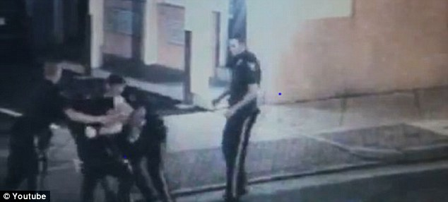 Arrest: Four officers are seen here forcing Mr Castellani to the ground