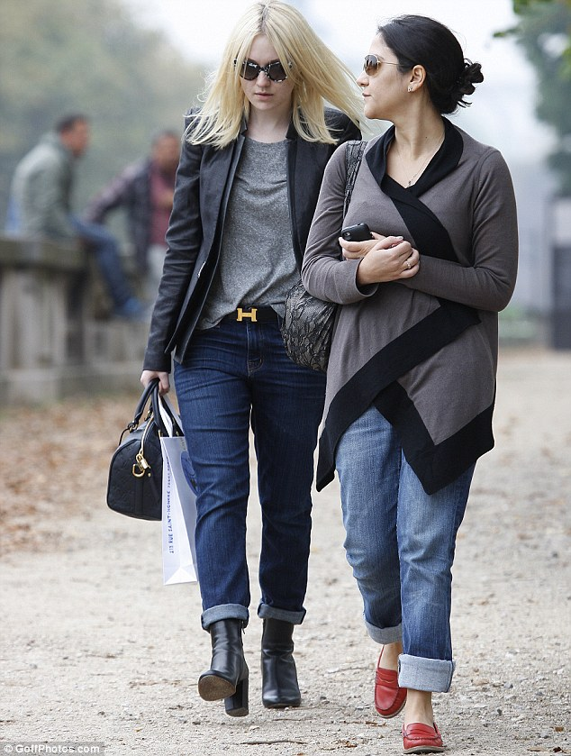 Casual stroll: Dakota is proving that she has her own unique style when it comes to fashion
