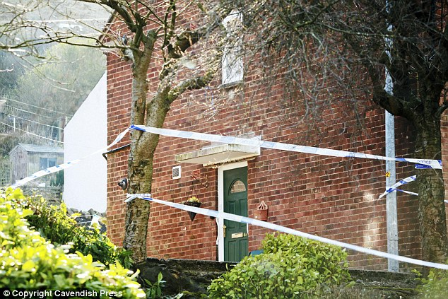 Scene: Police cordoned off the house where Brian was dragged out of by his son Anthony