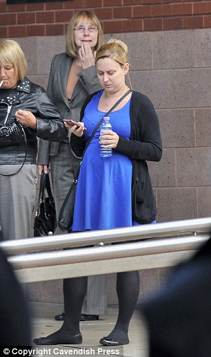 Anthony's sister Rebecca Gosling in blue dress standing outside Preston Crown Court