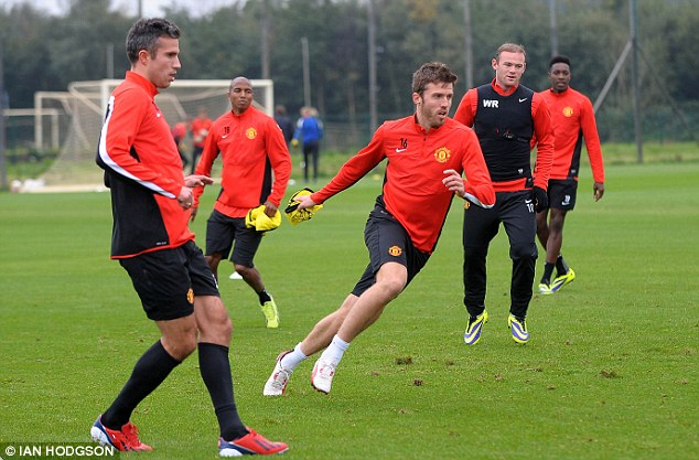 Piggy in the middle: Michael Carrick put through his paces at Carrington