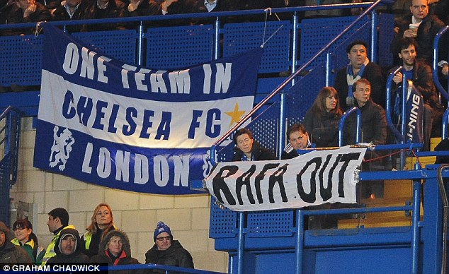 Chelsea fans hang their banners protesting about the appointment of Rafa Benitez