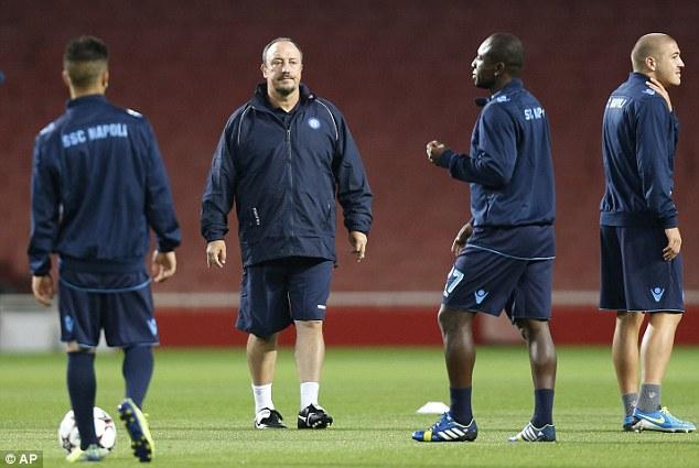 High praise: Rafael Benitez (above centre) believes Arsene Wenger (below) is the best manager in England