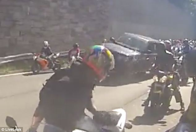 The moment a Range Rover driver accelerated away from a pack of motorcyclist, taking out several in its path