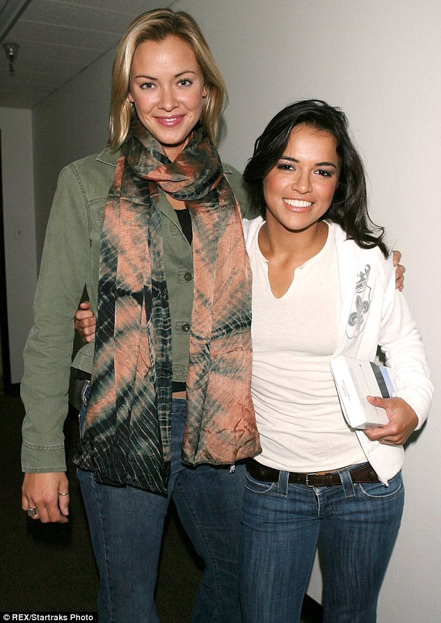 Linked: Michelle with Kristanna Loken in 2006; the BloodRayne co-stars were the subject of romance rumours