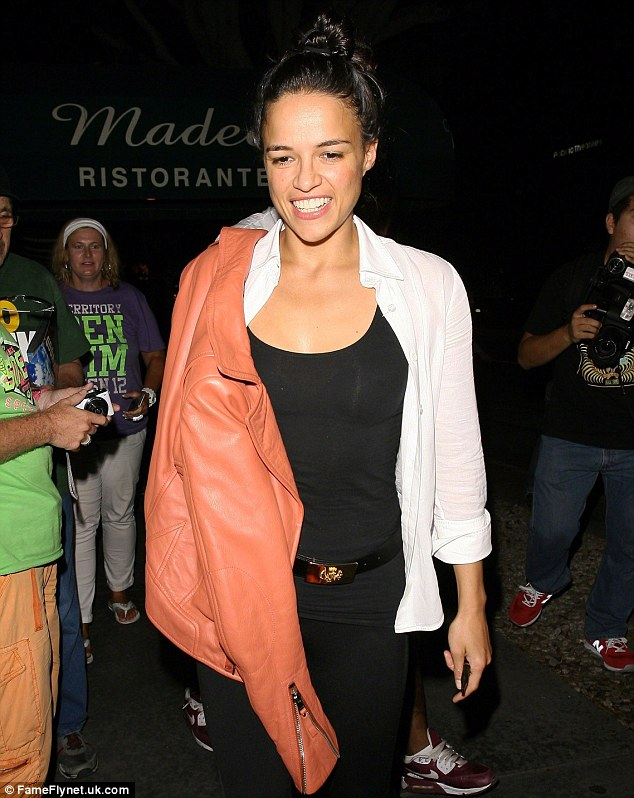 Opening up: Fast and Furious' star Michelle Rodriguez pictured out in Los Angeles in August; she has revealed she is attracted to both men and women