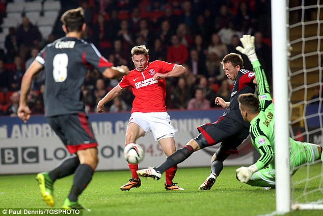 No cigar: Simon Church of Charlton can't quite reach the ball as Nottingham Forest clear the danger