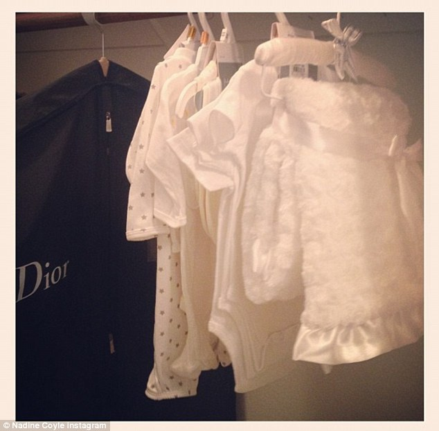 Splashing out: Nadine posted a photo of her unborn child's designer wardrobe on Instagram