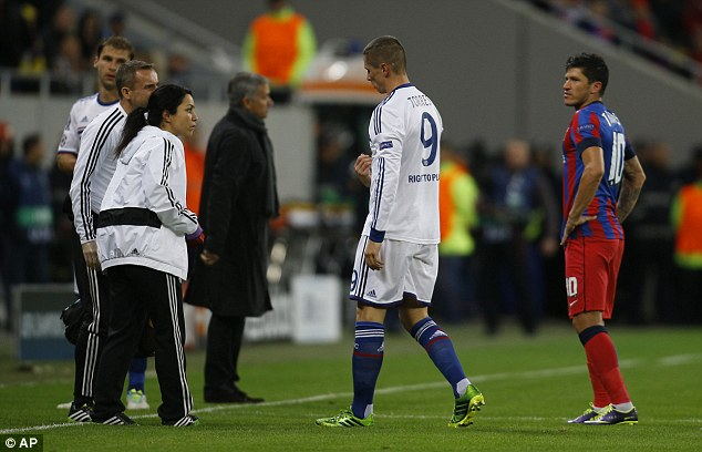 Limping off: Torres was substituted after just 11 minutes for fellow striker Samuel Eto'o