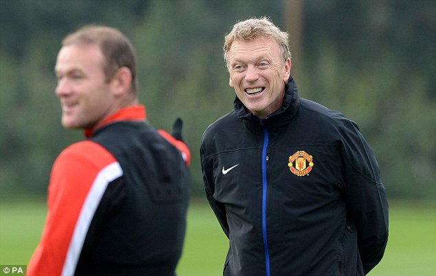 All smiles: Moyes looks on with glee as Wayne Rooney trains on Tuesday ahead of the clash in Donetsk