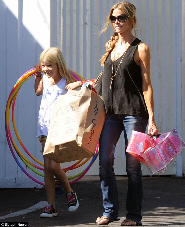 What a treat: Denise Richards took daughter Lola Rose shopping for toys at the Brentwood Country Mart on Tuesday