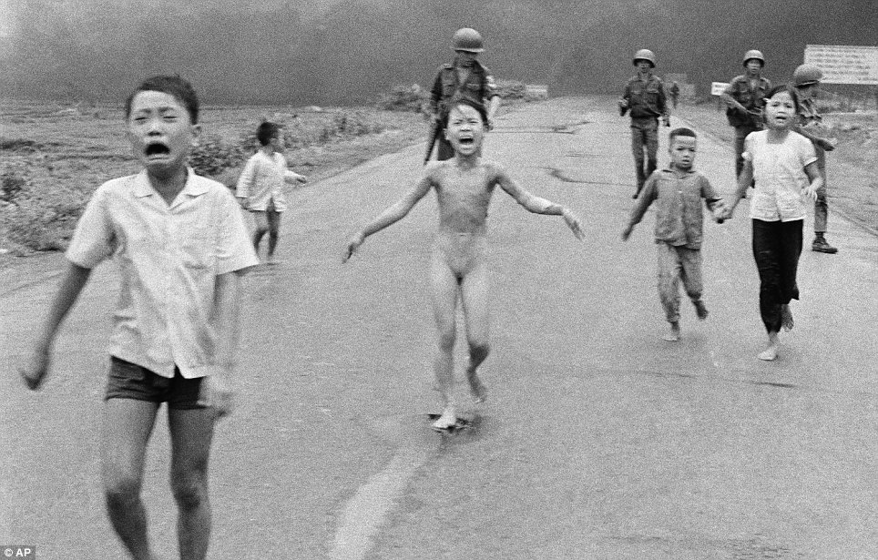 Screams: Young children run away from the site of a napalm attack on a suspected Viet Cong base in 1972