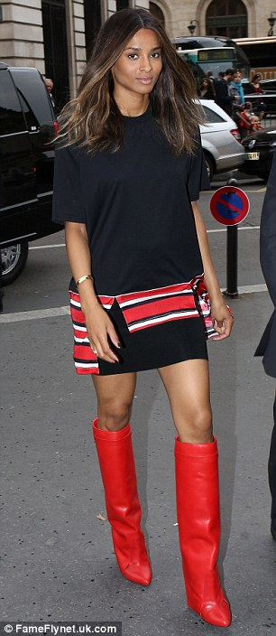 Thigh high: The singer has ramped up the sex appeal during PFW wearing sexy boots on a number of occasions