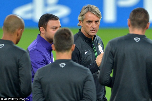 Moving on: Mancini (centre) has taken charge of Galatasaray and will face Tevez's Juventus on Wednesday