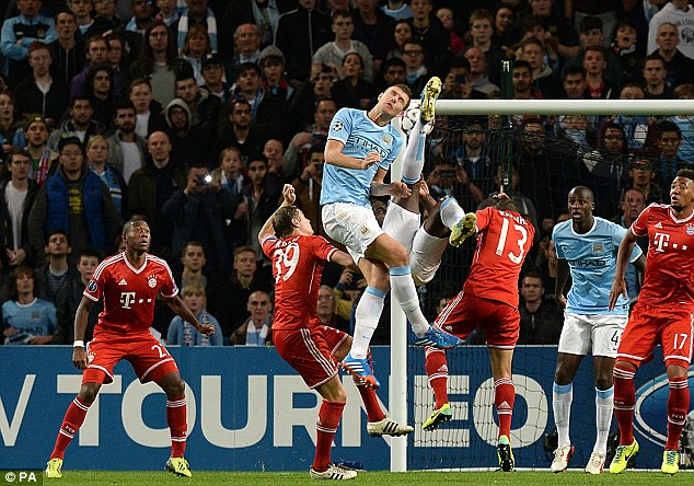 Aerial clash: Richards (centre) attempts a overhead kick as bayern and City players clash in the box