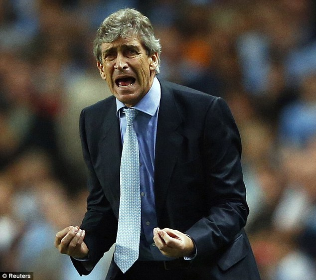 Desperation: City boss Manuel Pellegrini screams at his side from the touchline