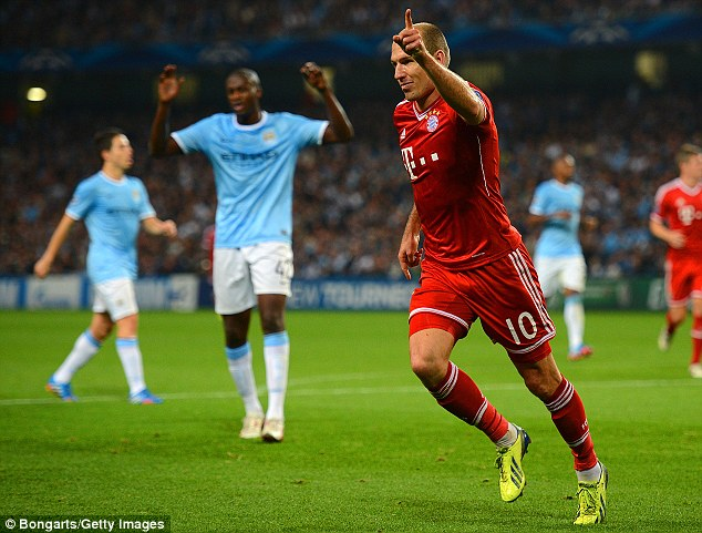 Turn on the style:  Arjen Robben of Muenchen celebrates his team's third goal