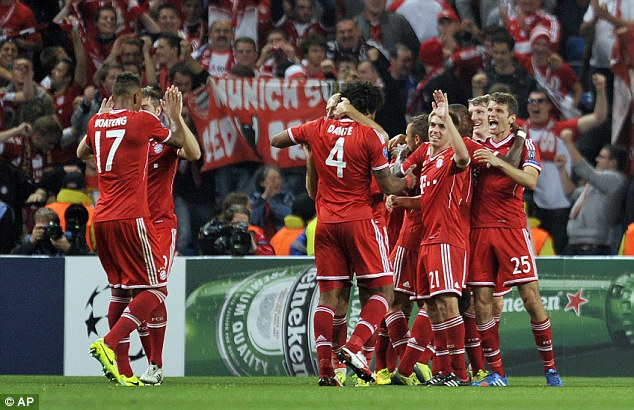 Celebration: Bayern Munich's Thomas Muller (right) celebrates with team-mates after making it 2-0