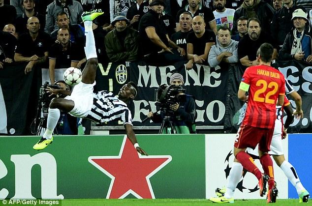 Going for glory: Juventus midfielder Paul Pogba takes an acrobatic shot