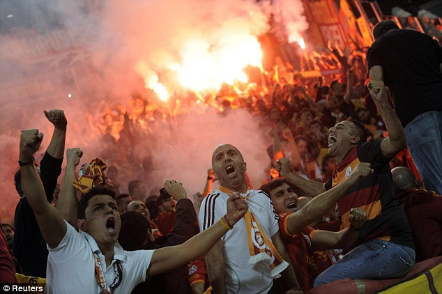 Traveling army: Galatasaray's fans celebrate Drogba's goal