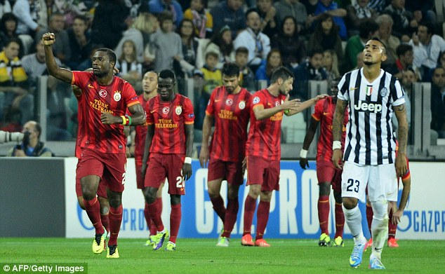 At the death: Galatasaray's players celebrate after scoring late on