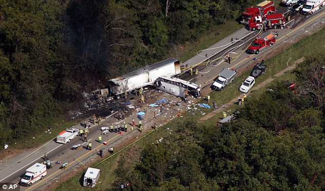 The tractor trailer rig burst into flames after the bus slammed into it. The fire was so intense it scorched trees along the highway