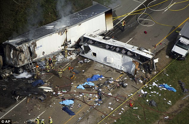 Tarps can be seen covering the bodies of the passengers who died when the church bus, right, crossed into oncoming traffic and slammed into a tractor trailer rig, left