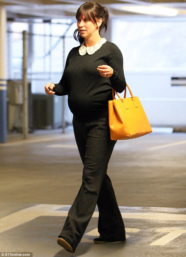 Tight and cosy: On Tuesday, Jennifer opted for a tight-fitting black knit as she ran errands