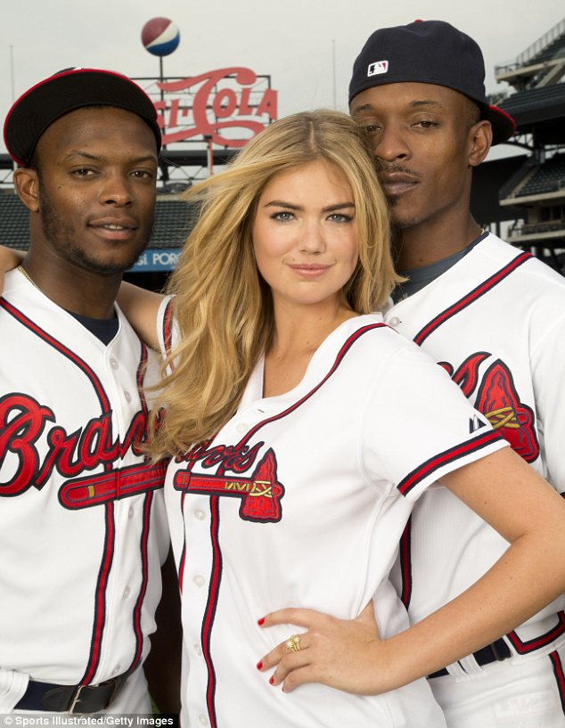 Is there anything she doesn't look good in? The swimwear model is stunning in her Atlanta Braves uniform for the new Sports Illustrated issue
