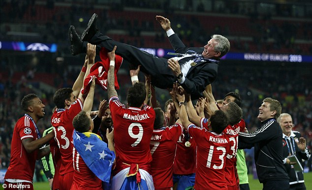 Tough act to follow: Bayern celebrate their success in May with Guardiola's predecessor Jupp Heynckes