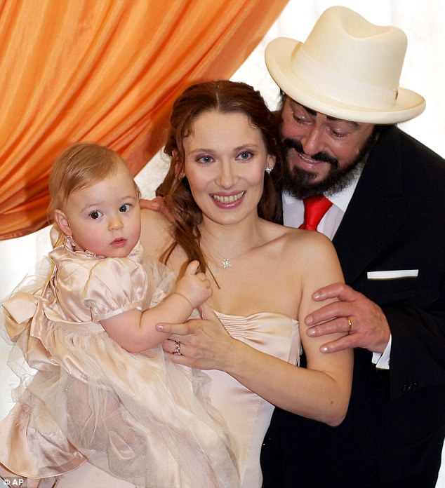 Italian opera singer Luciano Pavarotti looks at his bride Nicoletta Mantovani and their one-year-old daughter Alice after their wedding at Modena's Teatro Comunale, northern Italy IN 2003