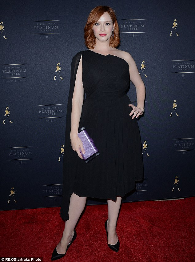 Solo style: Christina, who was without her husband Geoffrey Arend, accessorised her single-sash dress with a pearly purple clutch and black pumps